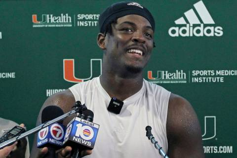 FILE - Miami NCAA college football defensive linemen Gregory Rousseau talks to the media after ...