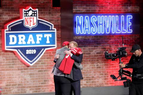 Commissioner Roger Goodell hugs Nick Bosa after Bosa was selected by the San Francisco 49ers wi ...