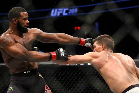 Tyron Woodley of the United States, left, fights Stephen Thompson of the United States during t ...