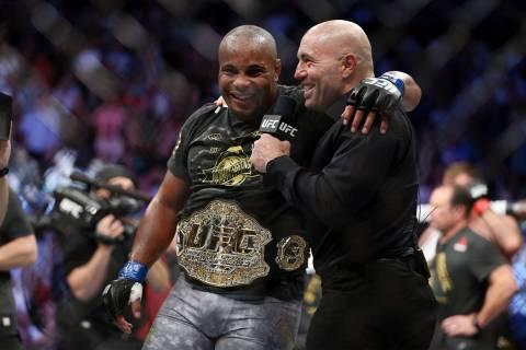 Daniel Cormier, left, with UFC commentator Joe Rogan, celebrates his knockout win against Stipe ...
