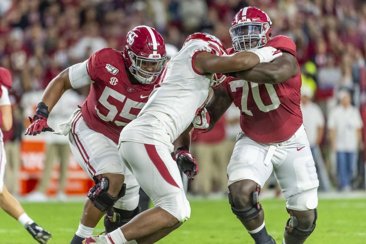 Alabama offensive lineman Alex Leatherwood (70) blocks Arkansas defensive lineman Mataio Soli ( ...