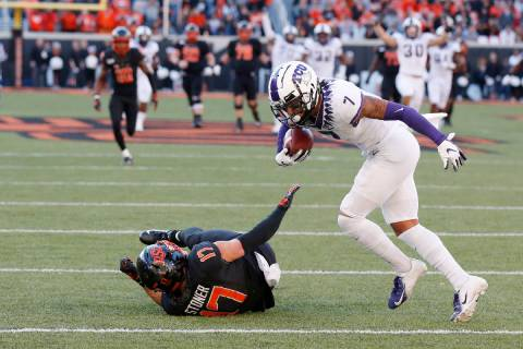 TCU safety Trevon Moehrig (7) comes down with the ball on an interception on a pass intended fo ...