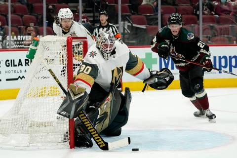 Vegas Golden Knights goaltender Robin Lehner (90) makes a save on a shot as Golden Knights defe ...