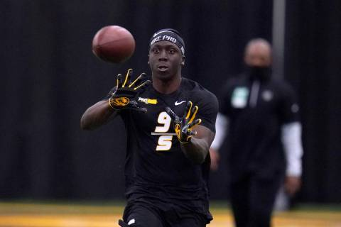 Missouri's Tyree Gillespie catches a ball as he participates in the school's pro day football w ...