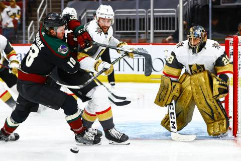 Golden Knights goaltender Marc-Andre Fleury (29) watches a rebound as Arizona Coyotes' Christia ...