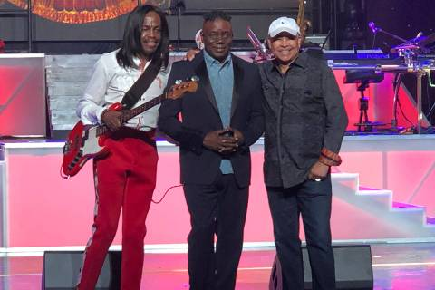 Verdine White, Philip Bailey and Ralph Johnson of Earth Wind & Fire are shown on stage during s ...