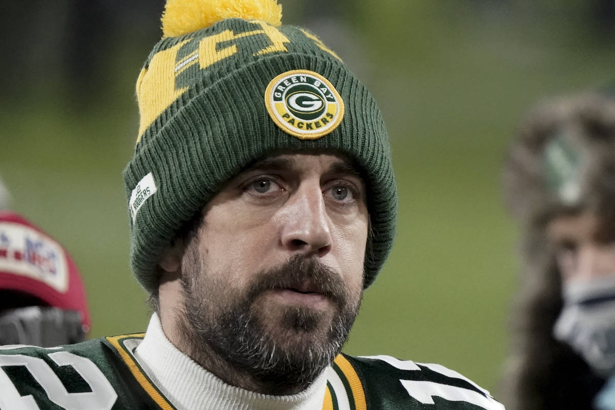 Green Bay Packers quarterback Aaron Rodgers (12) walks off the field after the NFC championship ...
