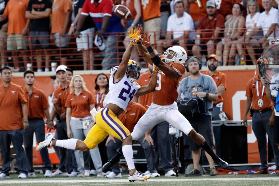 LSU cornerback Derek Stingley Jr., left, breaks up a pass intended for Texas wide receiver Coll ...