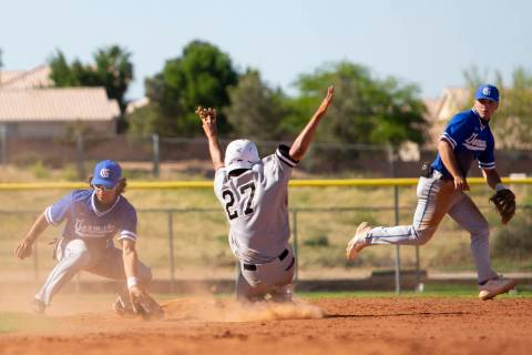 Bishop Gorman's second baseman Maddox Riske (2), left, catches a ground ball while Palo Verde's ...