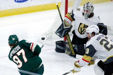 Minnesota Wild left wing Kirill Kaprizov (97) shoots on Vegas Golden Knights goaltender Robin L ...