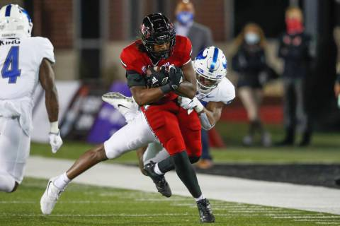 Northern Illinois Huskies tight end Daniel Crawford (88) is tackled by Buffalo Bulls defensive ...