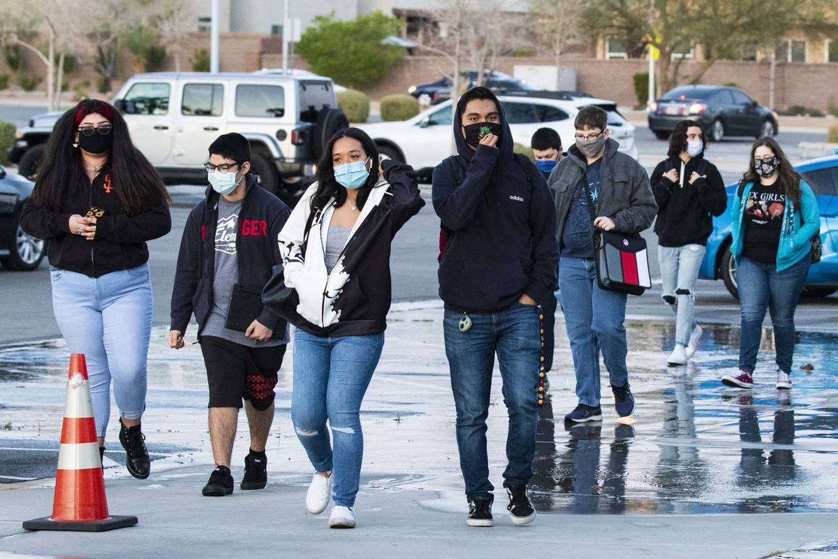 Students arrive at Liberty High School, on Monday, March 22, 2021, in Henderson. Clark County S ...