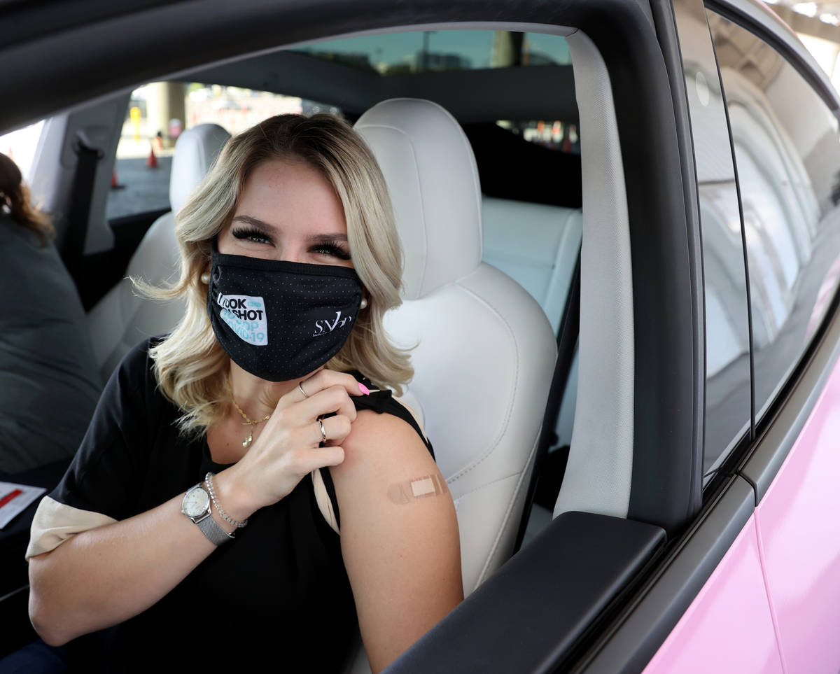 """Jenna Nye of Las Vegas dons her """"I took my shot to stop COVID-19"""" mask after receivin ..."""