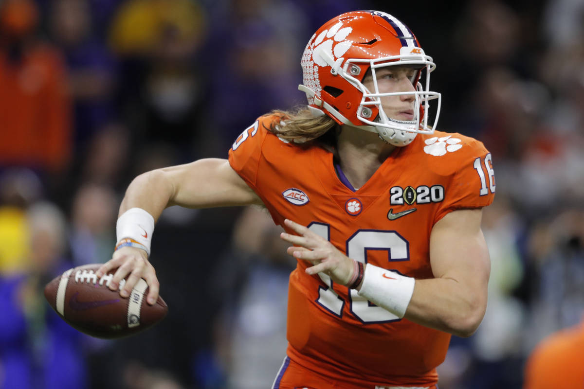 FILE - Clemson quarterback Trevor Lawrence passes against LSU during the second half of a NCAA ...