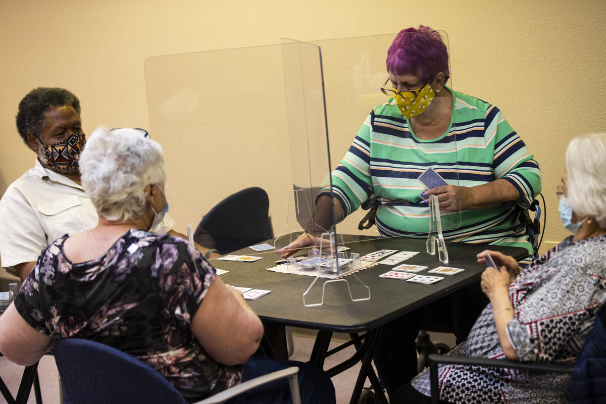 Dotty Ducret, right, and Gordon Dew, left, play the card game canasta at the West Flamingo Seni ...