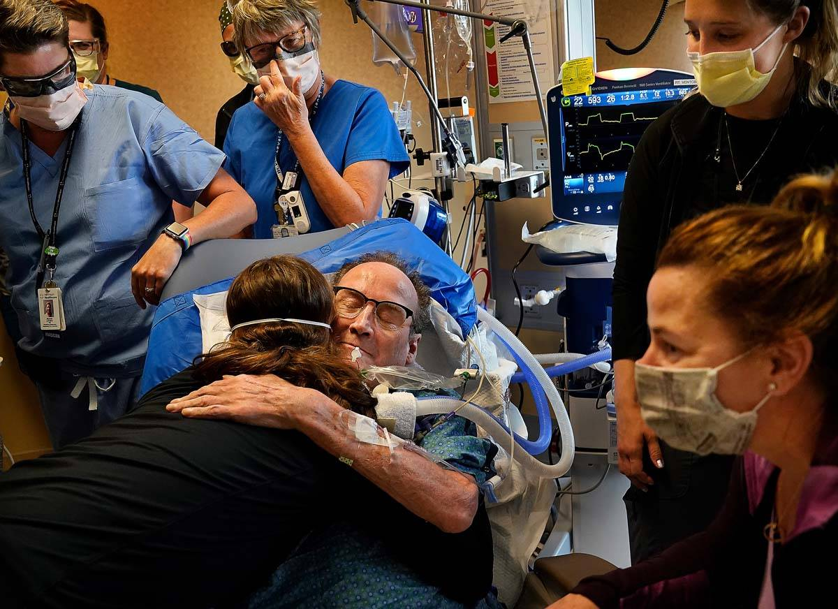 In this May 3, 2021, file photo, Hennepin County Medical Center patient John Grubb, of St. Mich ...