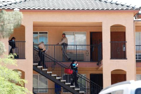 Las Vegas police and their Crime Scene Investigations team leave an apartment unit in Emerald S ...