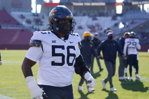 West Virginia defensive lineman Darius Stills walks off the field after warm ups before an NCAA ...