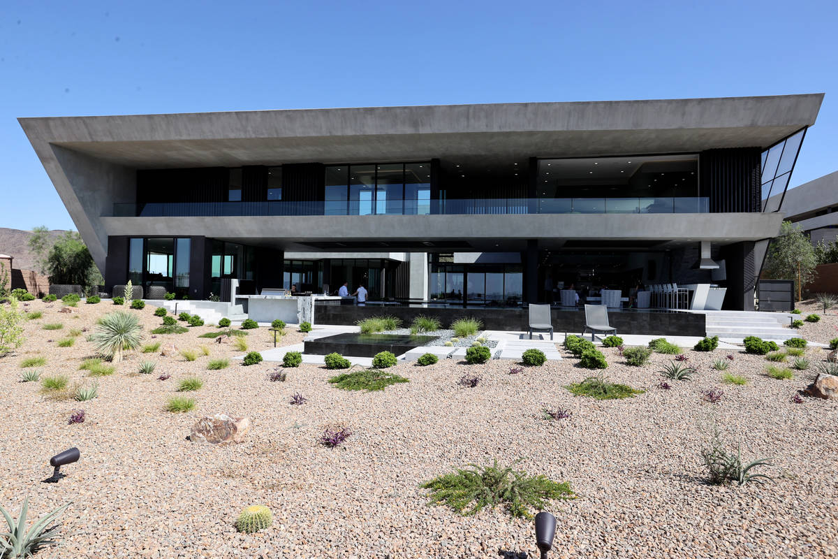 A custom-built home at 681 Dragon Peak Drive in Henderson is shown during a broker preview Thur ...