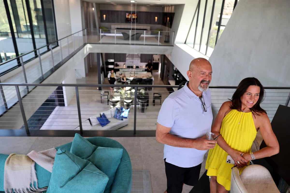 Realtor Vanessa Hamrick and her husband Lance at custom-built home at 681 Dragon Peak Drive in ...
