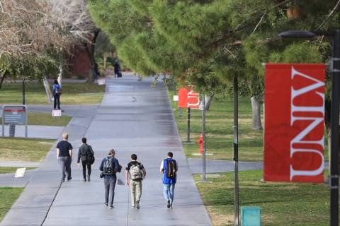 Students walk along a sidewalk at UNLV. (Las Vegas Review-Journal)