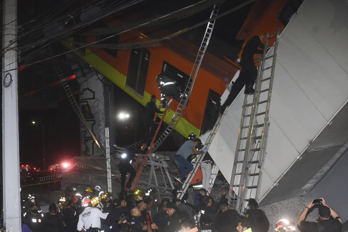 Mexico City fire fighters and rescue personnel work to recover victims from a subway accident a ...