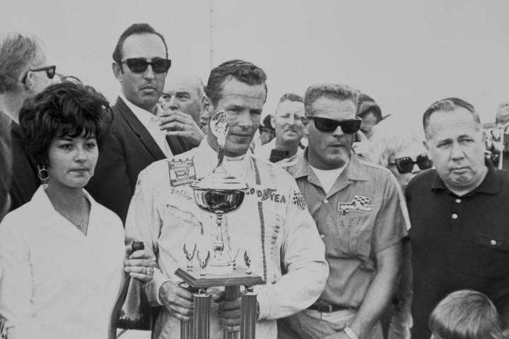 Bobby Unser is shown with the winner's trophy after taking the checkered flag at the 1968 Stard ...