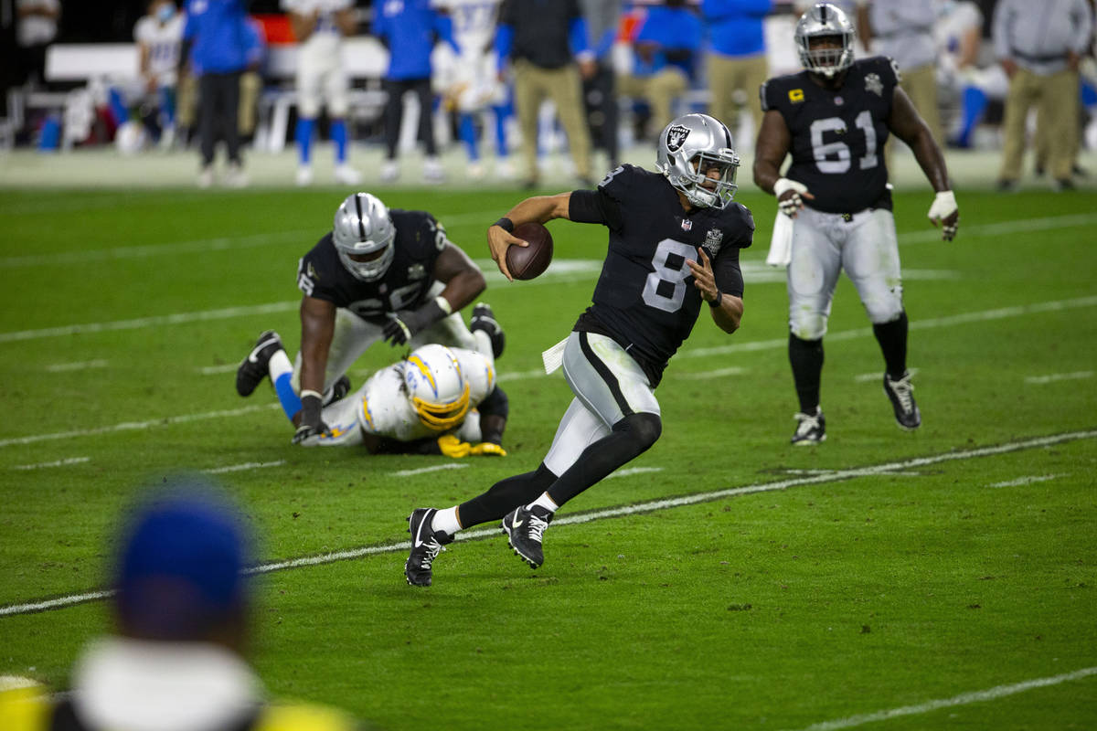 Raiders quarterback Marcus Mariota (8) rushes with the football during the fourth quarter of an ...