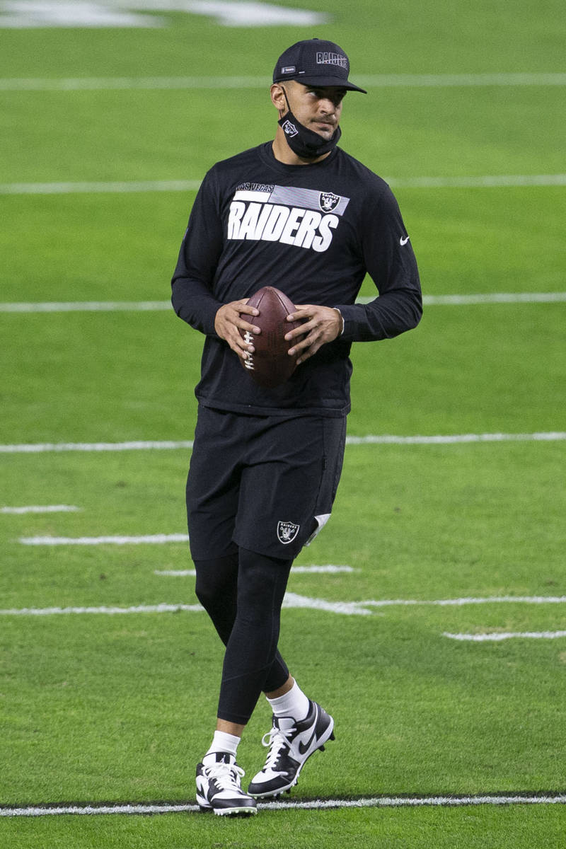Raiders quarterback Marcus Mariota (8) warms up before an NFL football game against the Miami D ...