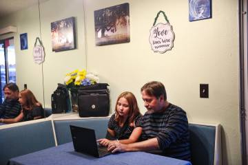 Isabella Wetsel, 12, works on homework with her dad Don Collins at their home in Las Vegas Sund ...