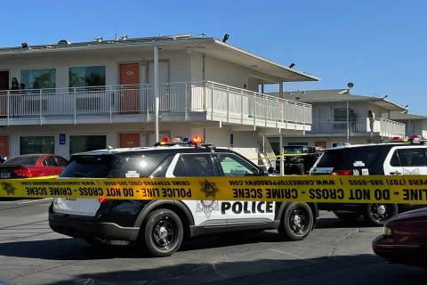 Las Vegas police investigate a homicide around the 100 block of East Tropicana Avenue, near Kov ...