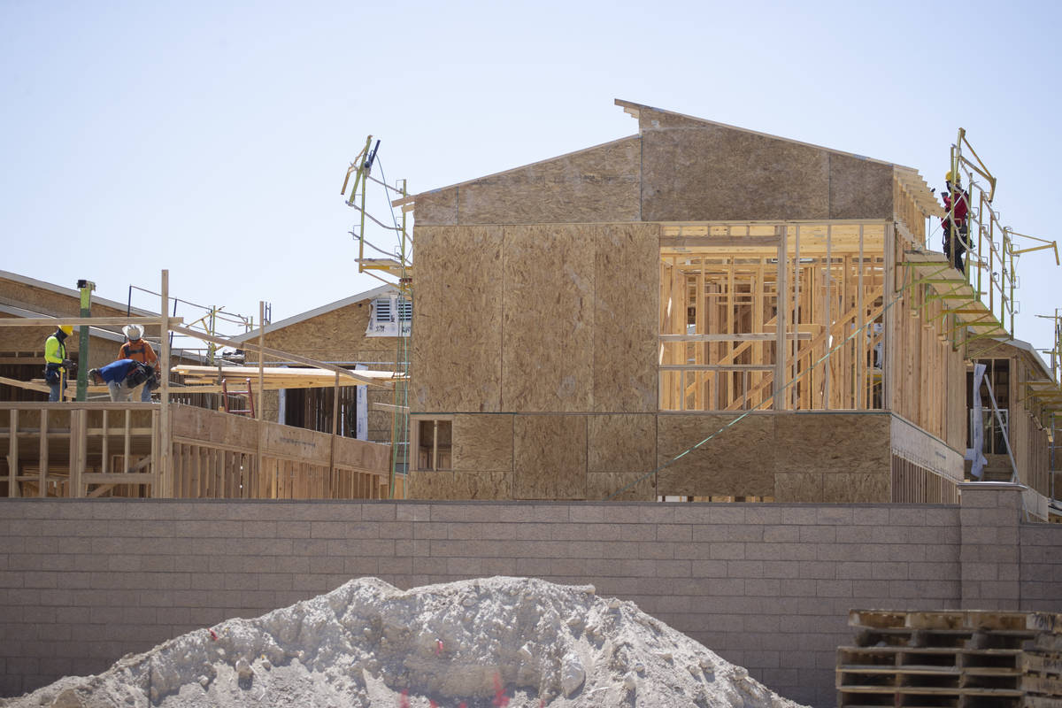 Construction workers build new homes near W Elkhorn Road and N Aviary Way in North Las Vegas, F ...