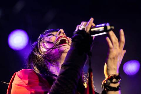 """Elyzabeth Diaga, lead singer in """"Queens of Rock,"""" performs at Mosaic on the Strip dur ..."""
