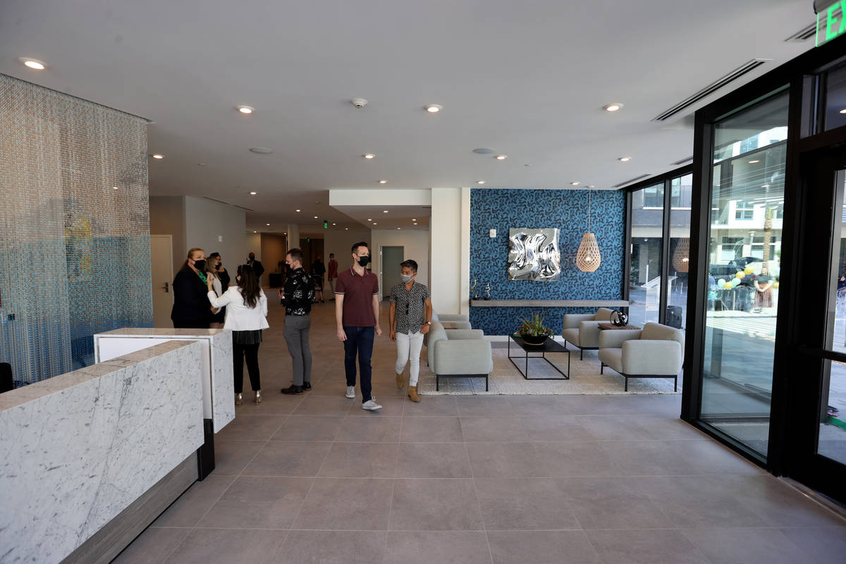 People mingle in the main lobby at Parc Haven apartment complex at Symphony Park in downtown La ...