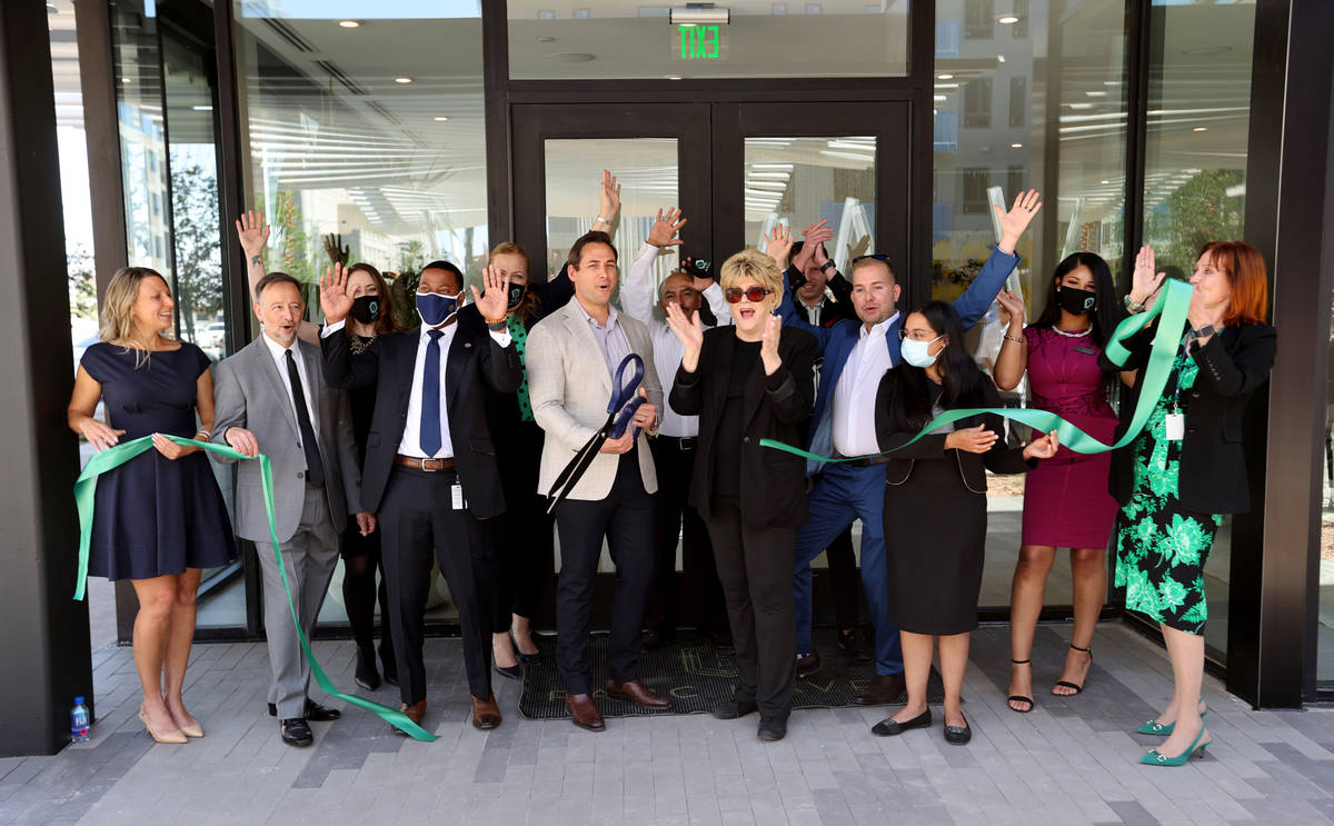 Patrick Brennan, development manager for Aspen Heights Partners, center, celebrates with Clark ...