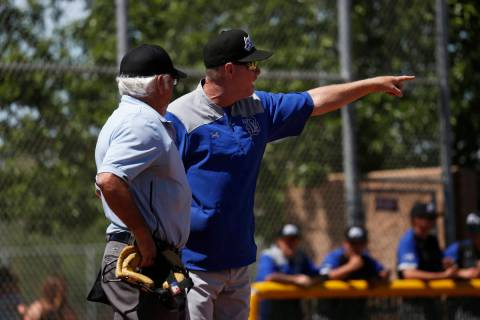 Basic head coach Scott Baker questions the umpire's call during the fourth inning of a game aga ...