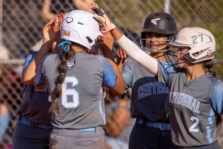 CentennialÕs Madison Lucero (6, left) is congratulated by teammates for a home run shot dr ...