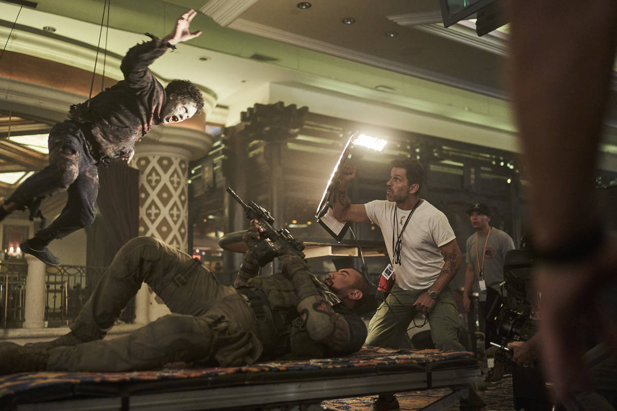 """Actor Dave Bautista and director Zack Snyder are shown on the set of """"Army of the Dead."""" (Clay ..."""