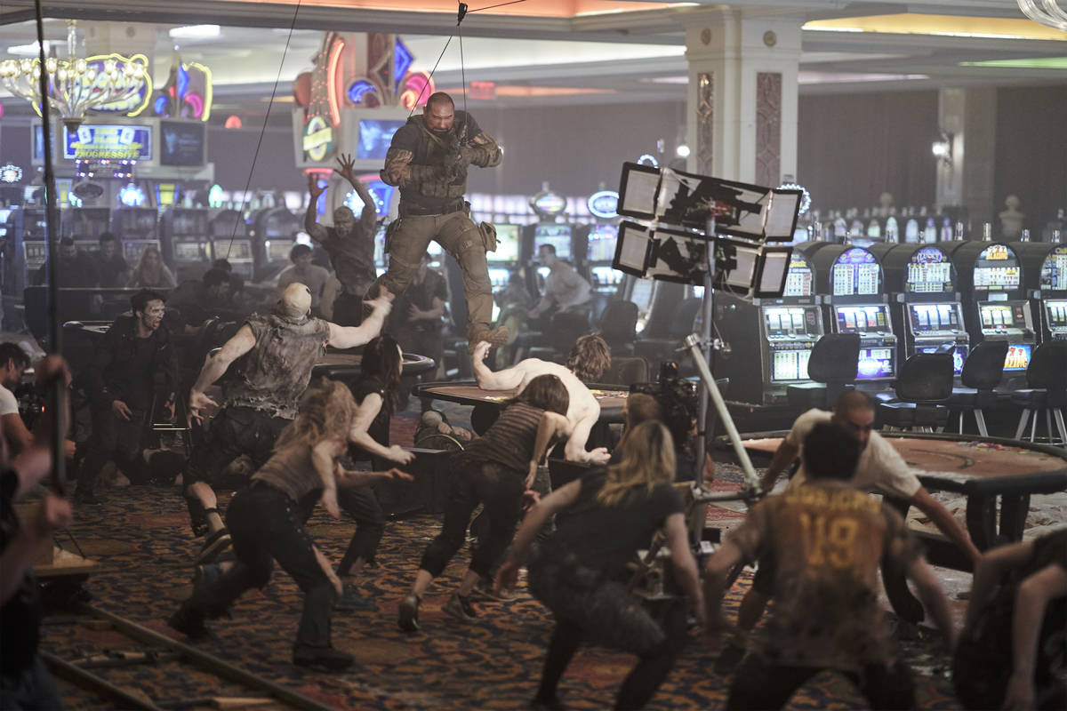 """Dave Bautista battles a casino filled with zombies while filming a scene from """"Army of the Dead ..."""