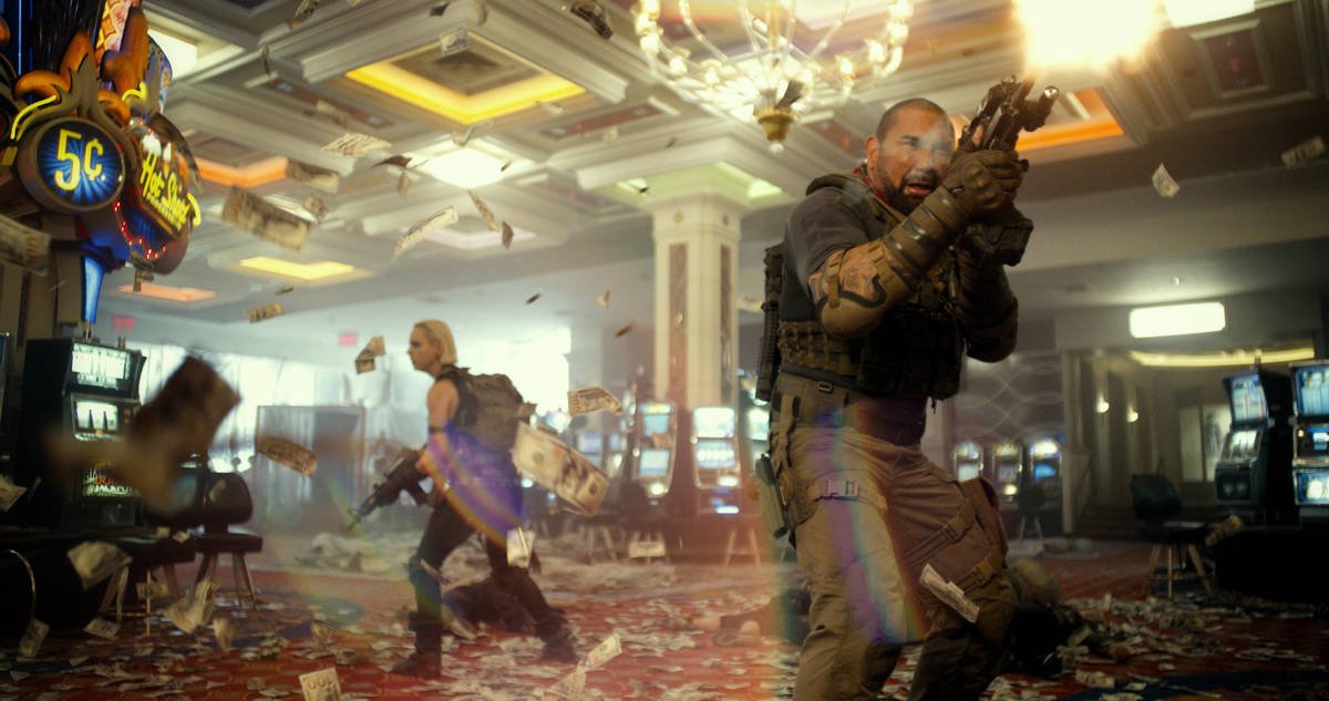 """Scott Ward (Dave Bautista) fights his way through a Las Vegas casino in a scene from """"Army of t ..."""