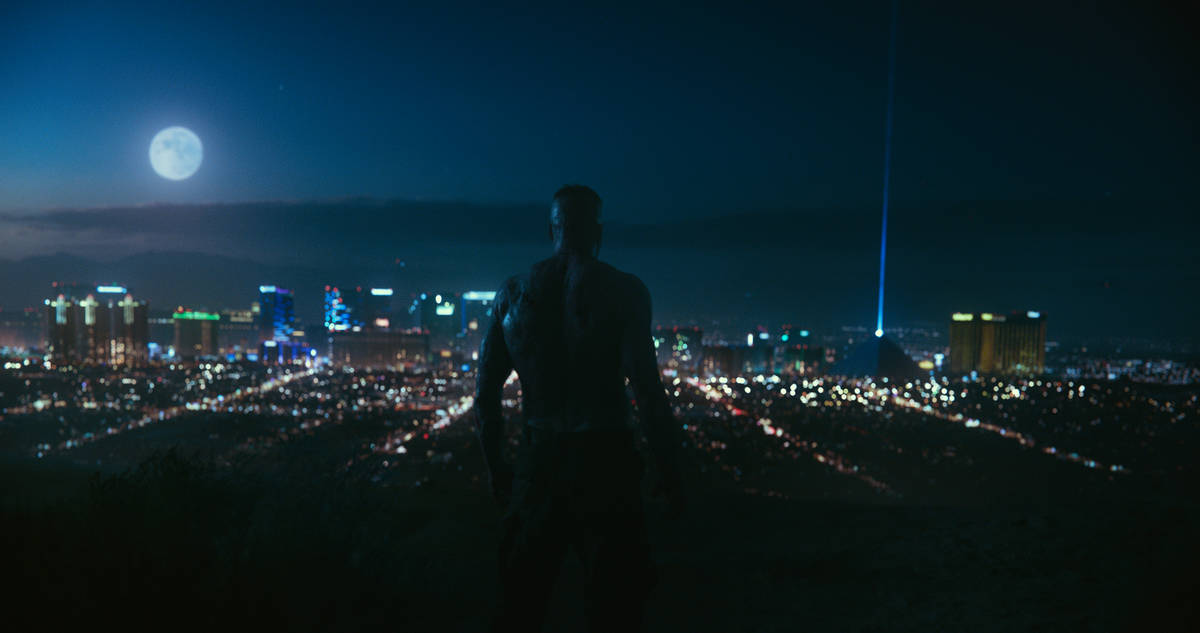 """An escaped zombie looks out at the Las Vegas skyline in a scene from """"Army of the Dead."""" (Netflix)"""