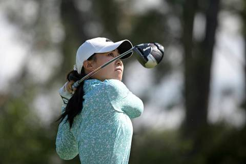 Danielle Kang watches after hitting her tee shot on the seventh hole during the final round of ...