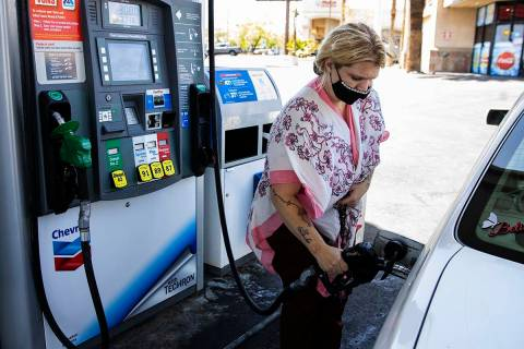 Crystal Tippit of Orange County, Calif., pumps gas at Chevron on Tropicana Avenue, on Wednesday ...