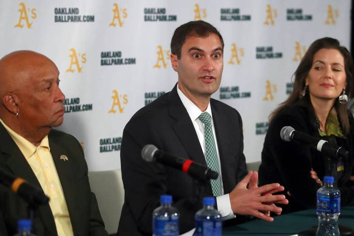 Oakland Athletics President Dave Kaval, center, speaks beside Oakland Mayor Libby Schaaf, right ...