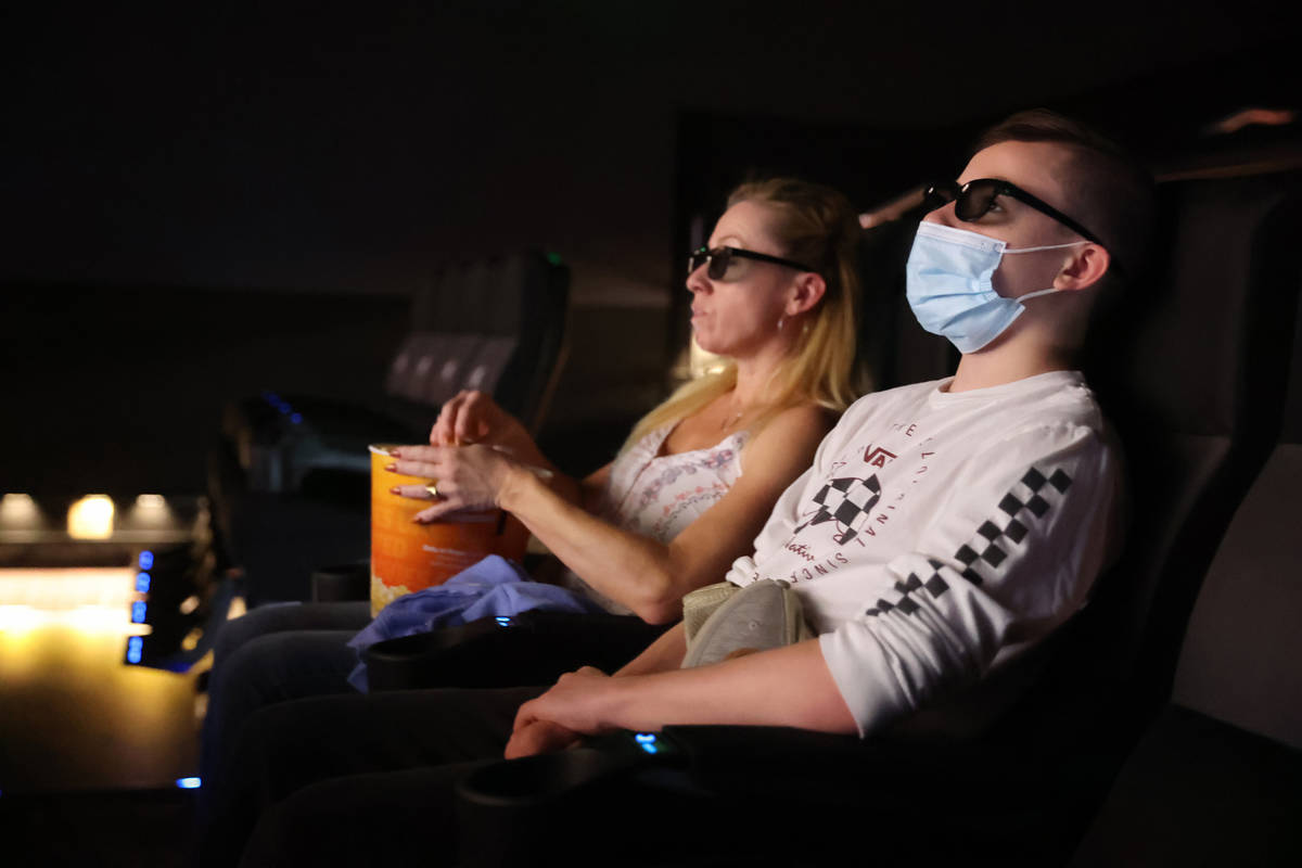 """Taylor and Patti Schoffstall of San Diego watch the 4D release of """"Godzilla vs. Kong"""" ..."""