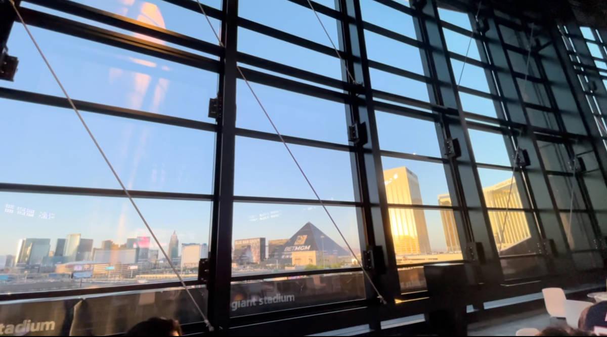 View looking out Allegiant Stadium's lanai doors toward the Las Vegas Strip. (Mick Akers/Las Ve ...