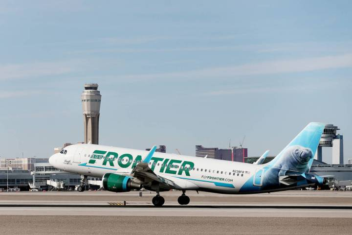 A Frontier Airlines plane lands at the McCarran International Airport in Las Vegas on Thursday, ...
