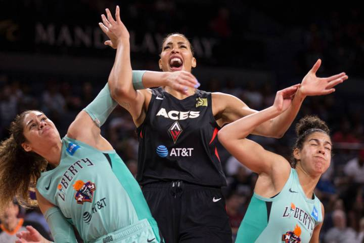 Las Vegas Aces center Liz Cambage (8) fights for position with New York Liberty center Amanda Z ...