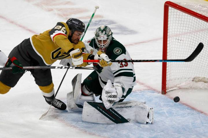 Vegas Golden Knights left wing William Carrier (28) tries to shoot agains Minnesota Wild goalte ...