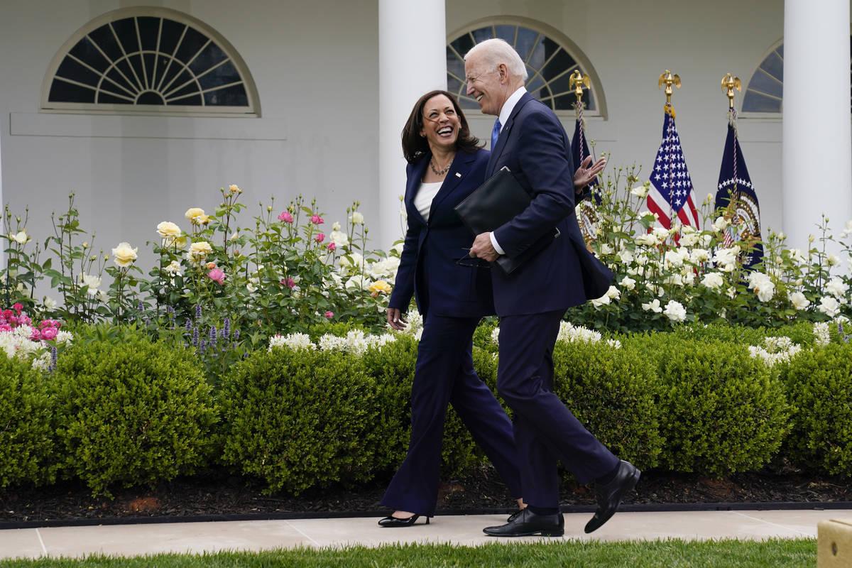 President Joe Biden walks with Vice President Kamala Harris after speaking on updated guidance ...